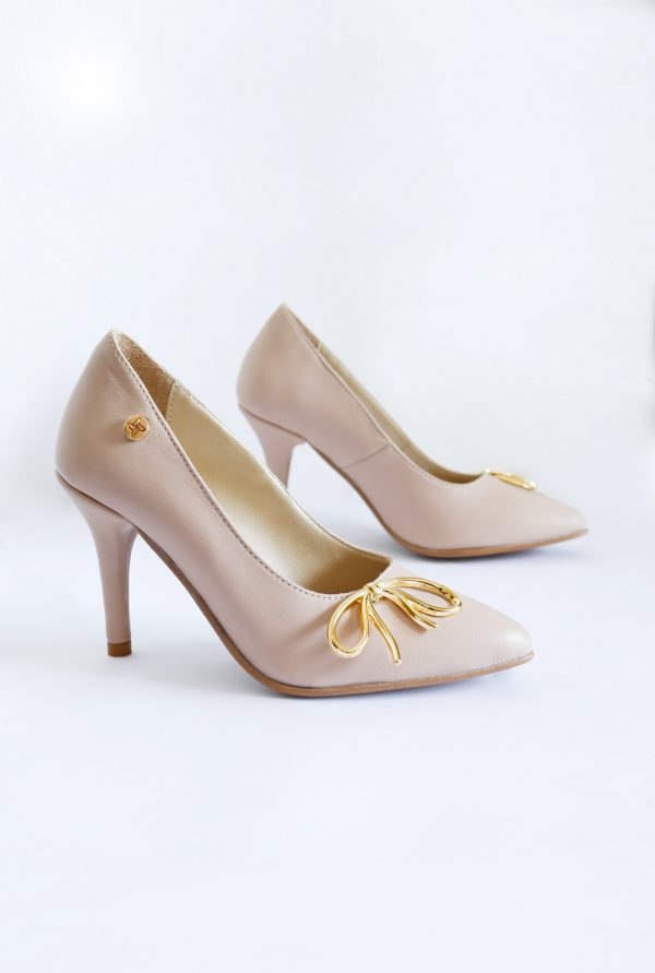 Nude stilettos with golden bow on the sides